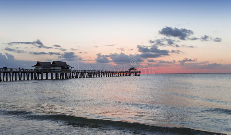 Pier jetty at sunset in Naples, forida, usa. A view in NAPLES, UNITED STATES, NOVEMBER 30, 2017 : pier jetty at sunset , november 30 2017, in Naples, Florida stock photography