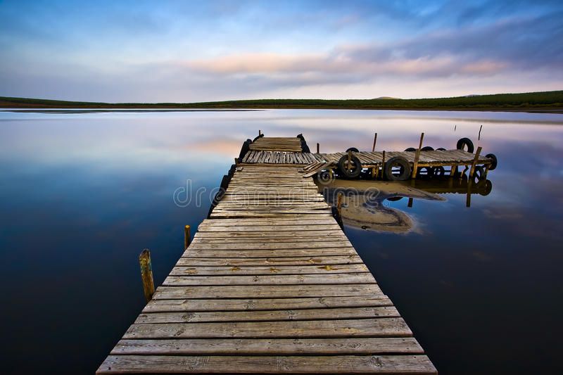 Pier on lake stock images