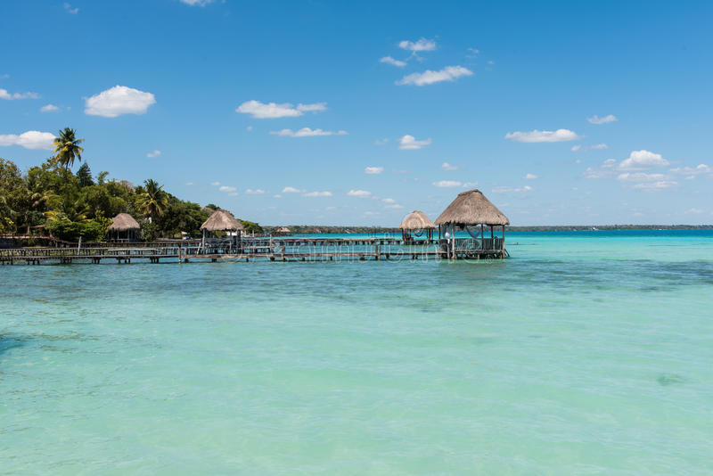 Pier on the lake in Bacalar, Mexico. Pier`s & palapa`s on lake Bacalar in Mexico stock photos