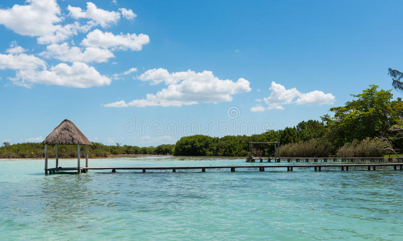Pier on the lake in Bacalar, Mexico. Pier`s & palapa`s on lake Bacalar in Mexico royalty free stock images