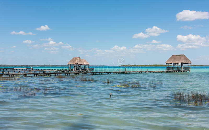 Pier on the lake in Bacalar, Mexico. Pier`s & palapa`s on lake Bacalar in Mexico stock photo