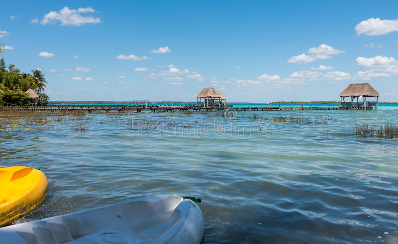 Pier on the lake in Bacalar, Mexico. Pier`s & palapa`s on lake Bacalar in Mexico royalty free stock photos