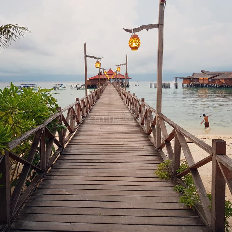 A pier on Mabul Island royalty free stock images