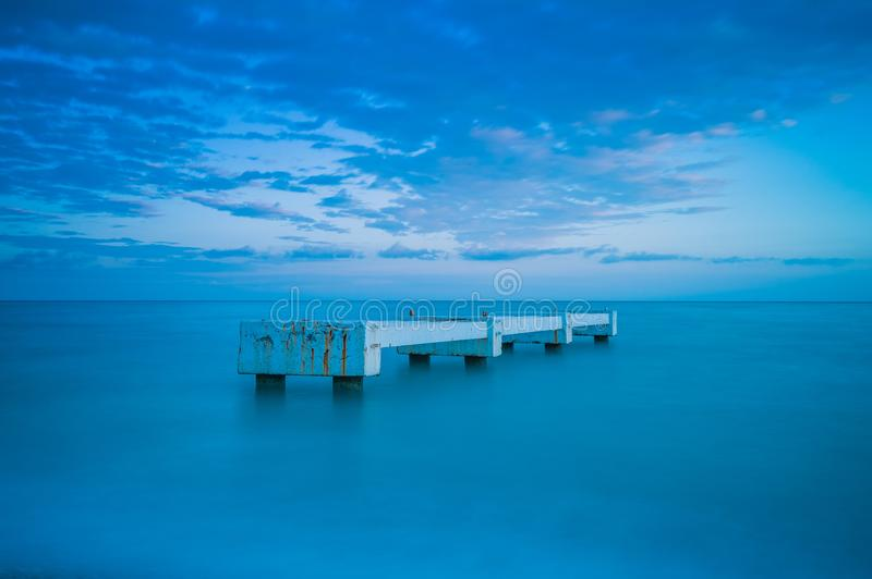 Pier in the middle of the sea royalty free stock photo