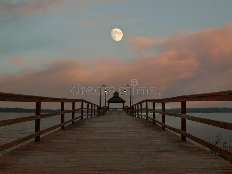 Pier And Moon Scene Stock Images