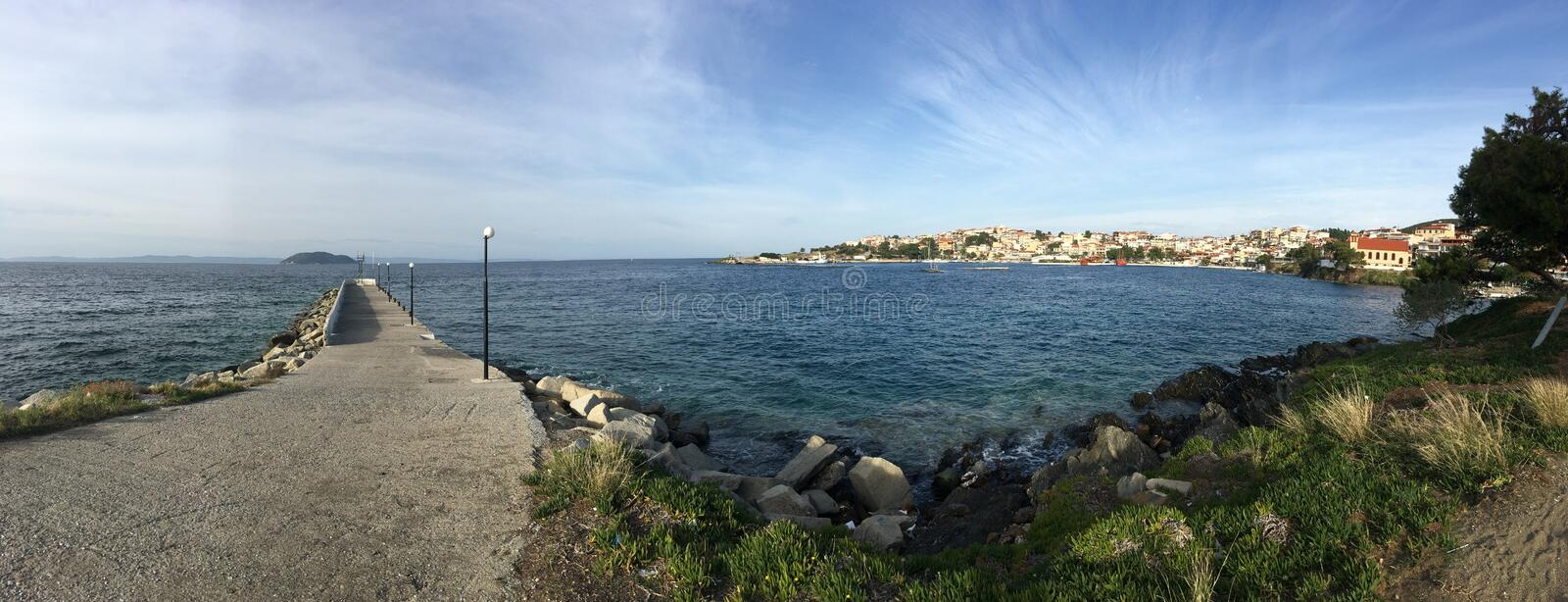 Pier in Neos Marmaras. Panorama royalty free stock photography