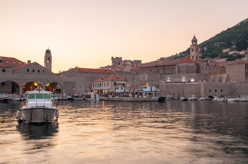 Pier in old town of Dubrovnik at sunset. Boats moored in old town pier of Dubrovnik at sunset stock photography