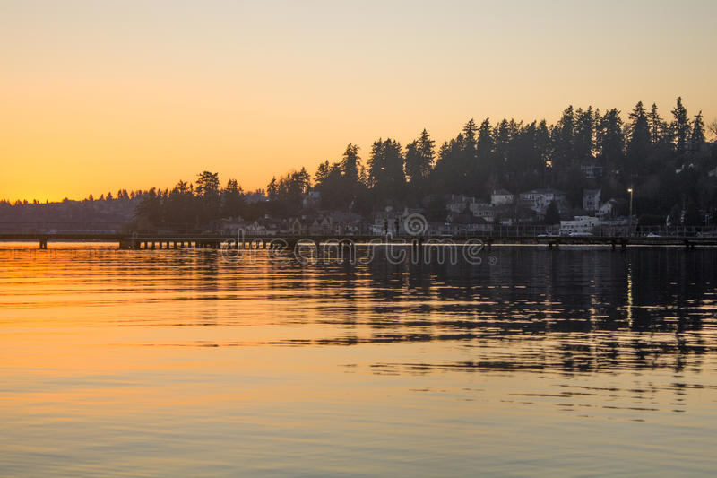 A pier over a lake on a winter sunset at Juanita Bay Park, Kirkland, Washington royalty free stock images