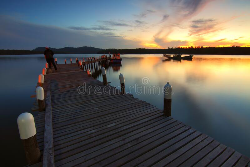 Pier over Sea Against Sky during Sunset royalty free stock photography