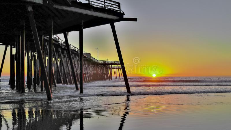 Pier at Pismo Beach, California. Pier at Pismo Beach, sunset at beach in California, pacific ocean royalty free stock photos
