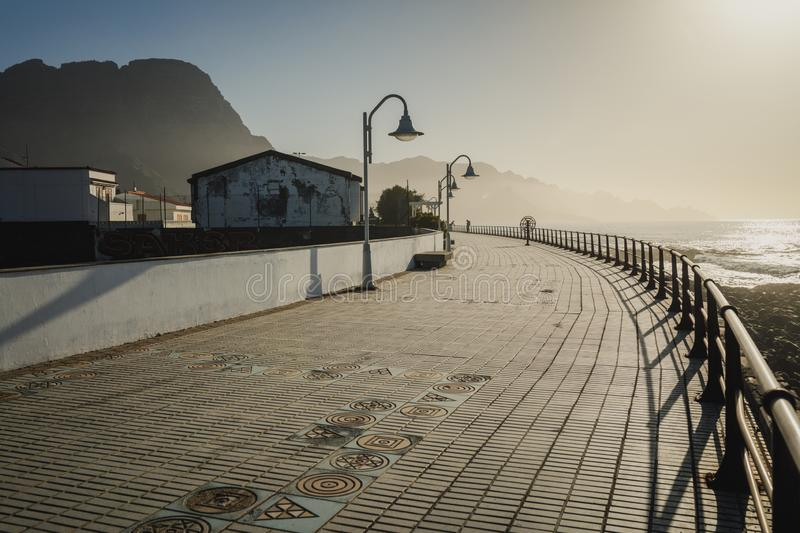 A pier in Puerto de las Nieves near Agaete on north west coast of Gran Canaria, Canary Islands. A view of ocean pier in Puerto de las Nieves near Agaete on north royalty free stock images