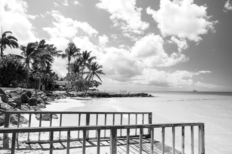 Pier with railing on tropical beach in st johns, antigua royalty free stock photo
