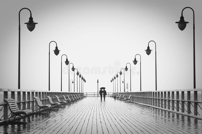 Pier in rain stock photo