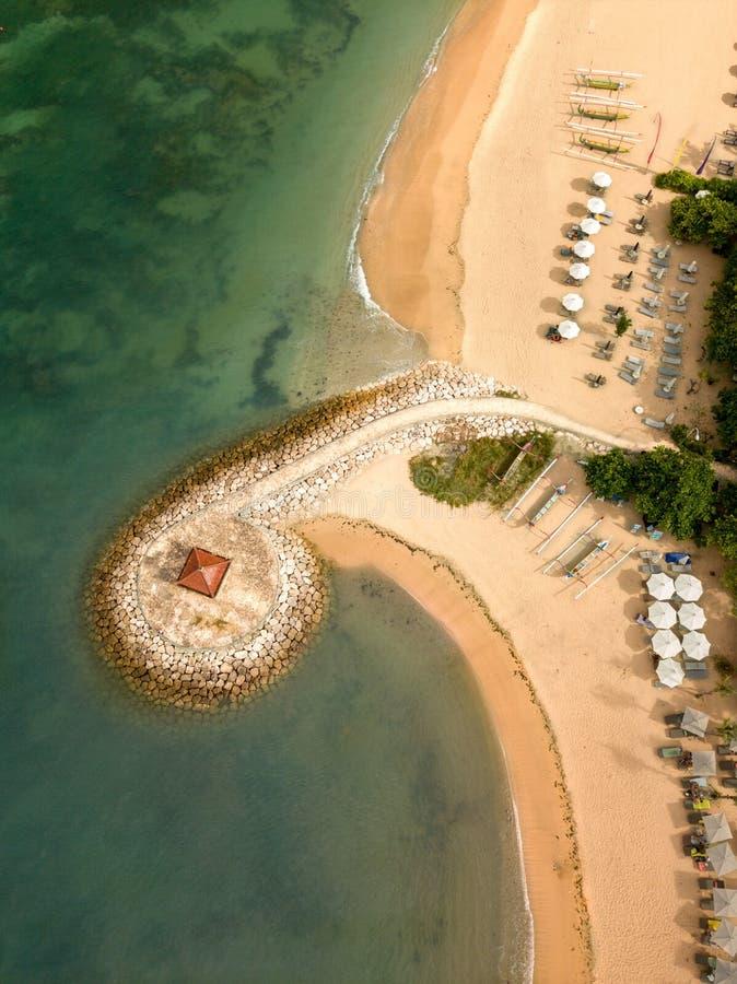 Sanur beach pier and umbrella stock photo
