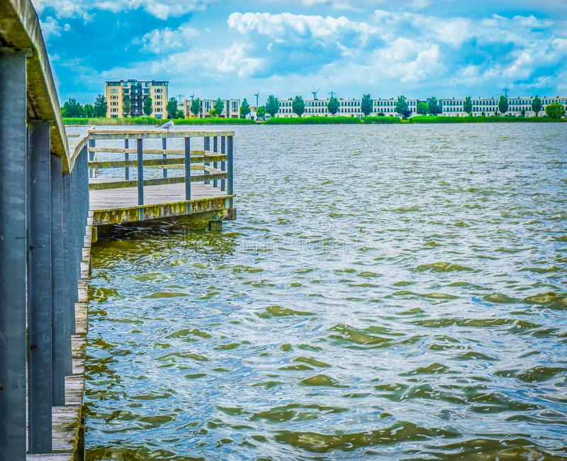 Pier with sea gull and city view stock image