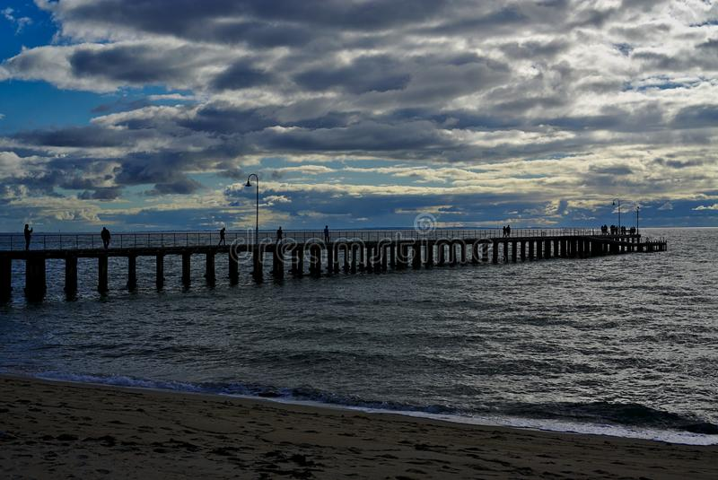 Pier with several people on it royalty free stock images