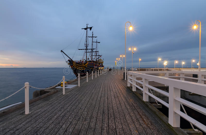 Pier and ships in Sopot at sunset, Poland. Europe royalty free stock image
