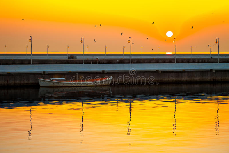 Pier in Sopot, Poland. Picturesque landscape of a sunrise with a boat on a pier in Sopot, Poland stock photo