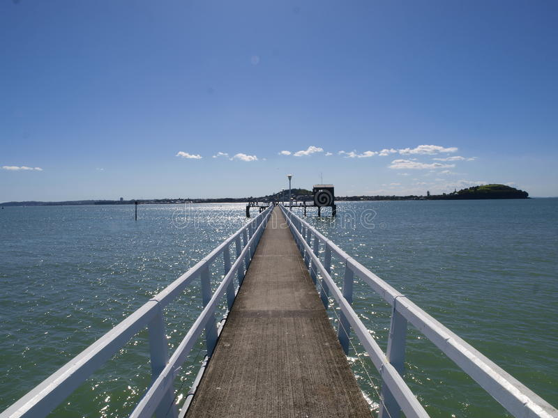 Pier in St Heliers. A pier or wharf running out to sea in St Heliers in Auckland stock photo