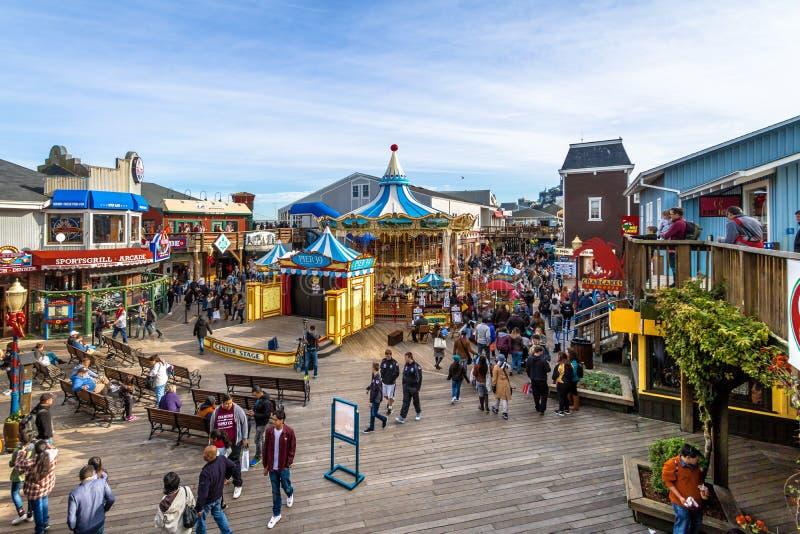 Pier 39 stores and Carousel in Fishermans Wharf - San Francisco, California, USA. SAN FRANCISCO, USA - December 26, 2016: Pier 39 stores and Carousel in stock image
