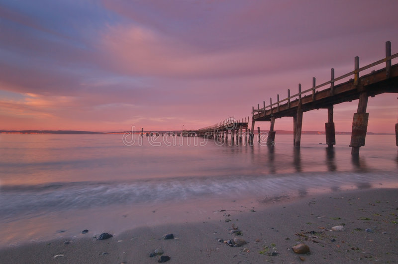 Pier at sunset royalty free stock images