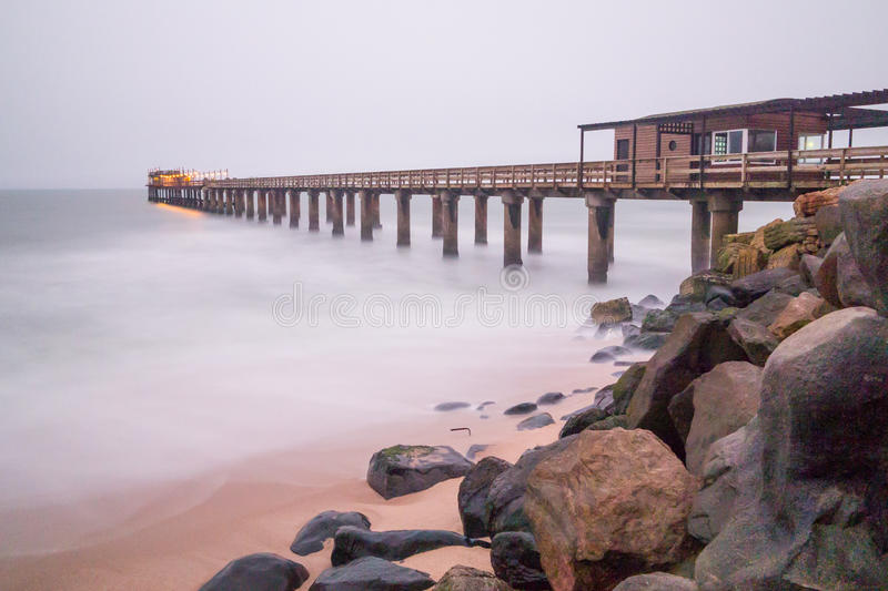 Pier at swakopmund in namibia. Long exposure of Pier at swakopmund in namibia stock photography