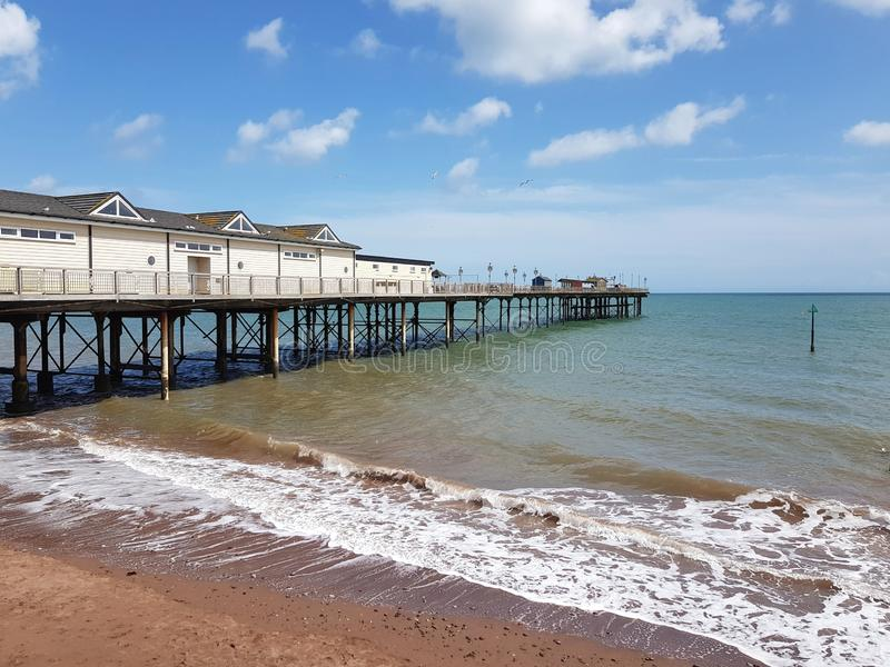 Pier in Teignmouth, United Kingdom. Sea front in Teignmouth, United Kingdom. Sea front in dawlish, united kingdom. sea front in , united kingdom. beach, tree royalty free stock photos