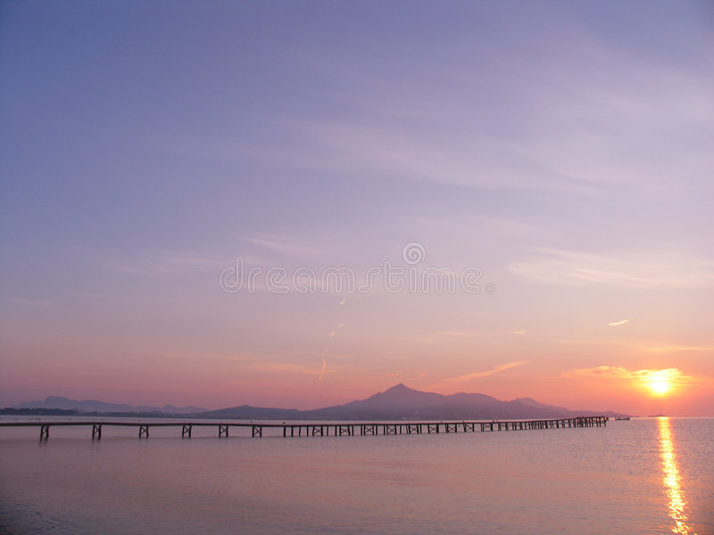 Pier to sunrise royalty free stock image