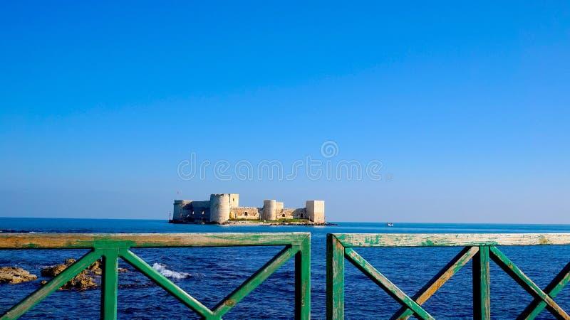 Old Pier with Kizkalesi Castle stock photography