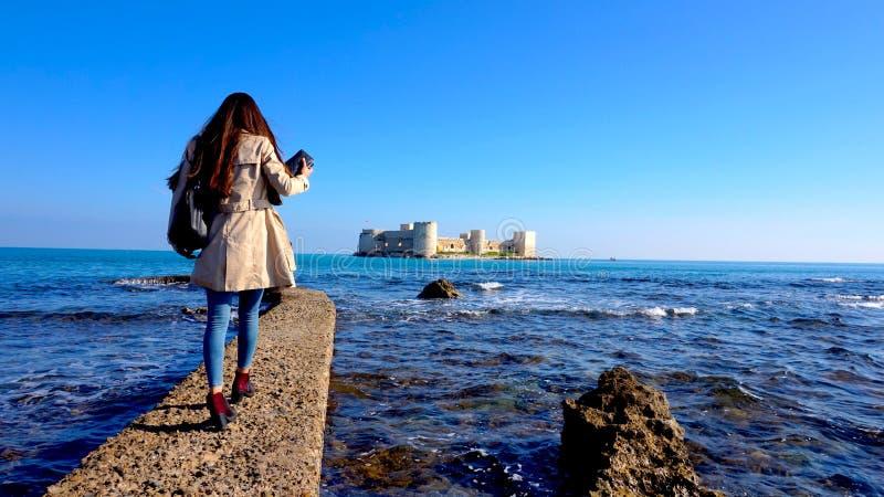 Pier with Kizkalesi Castle And Girl stock image