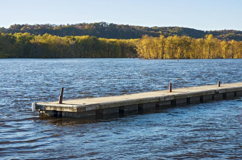Pier Waters and Woodlands of Mississippi River in Prairie du Chien. Pier waters and wooded islands of mississippi river backwaters during autumn in prairie du royalty free stock images