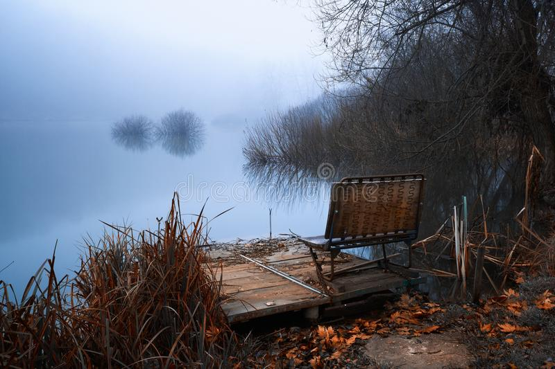 Pier on winter lake stock photography