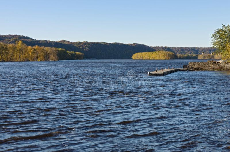 Pier and Wooded Banks of River at Prairie du Chien. Mississippi river and pier along bank with woodlands in distance at prairie du chien wisconsin stock photo