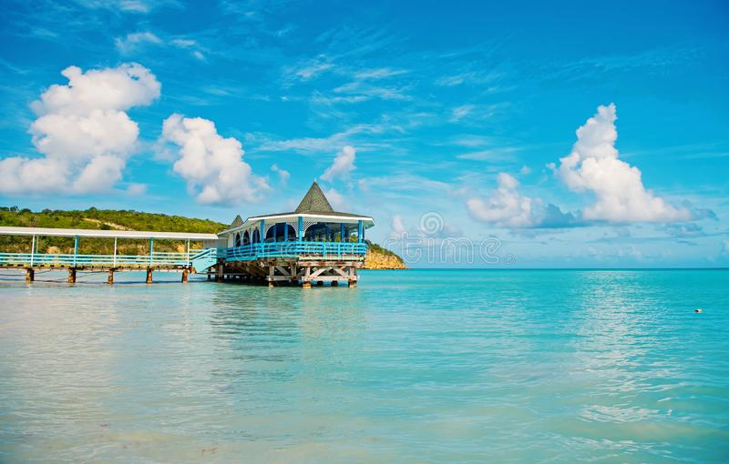 Pier with wooden shelter in sea in st johns, antigua stock photo