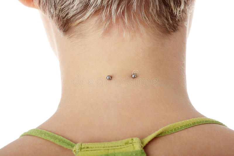 Piercing. On womans neck, isolated on white royalty free stock photos
