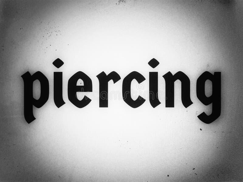 piercing em inglês word in black color font on the black and white background imagem de stock