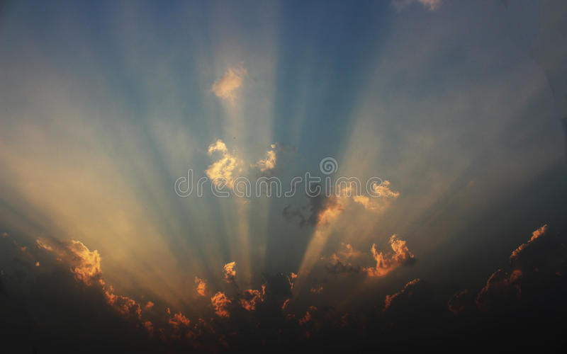 Piercing light rays through clouds royalty free stock photography
