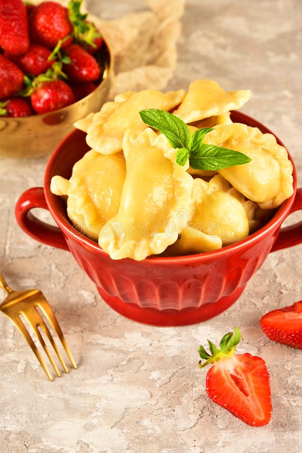 Pierogi. Dumplings with with strawberry . Ready meal. Pierogi. Dumplings with with strawberry . Ready meal stock images