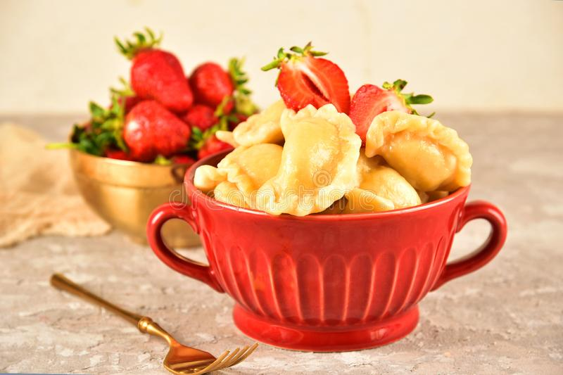 Pierogi. Dumplings with with strawberry . Ready meal. Pierogi. Dumplings with with strawberry . Ready meal royalty free stock image