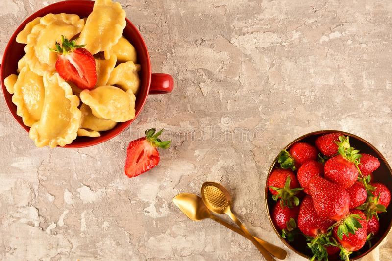 Pierogi. Dumplings with with strawberry . Ready meal. Pierogi. Dumplings with with strawberry . Ready meal royalty free stock photos