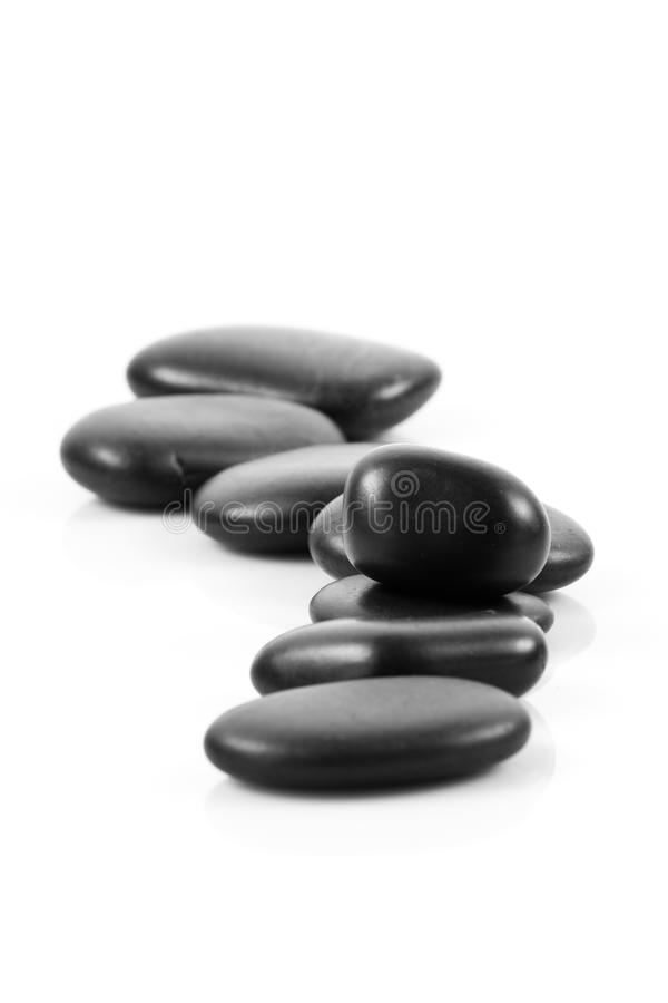 Pierres noires de massage empilées image stock
