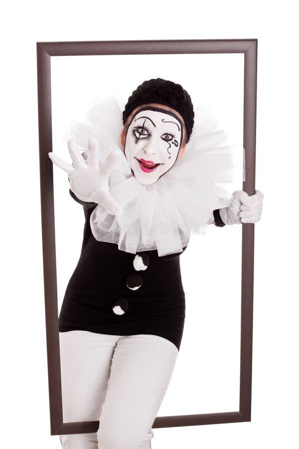 Pierrot femenino en un marco que alcanza la mano al espectador imagen de archivo libre de regalías