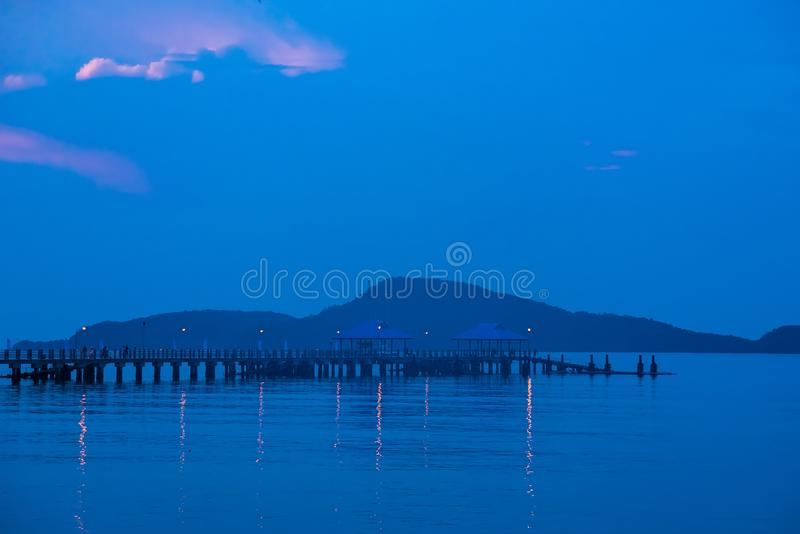 Piers in front of beach in the morning sunrise.Phuket.Thailand. Background bay beautiful blue boat cloud clouds coast coastline color colorful dawn destination royalty free stock image