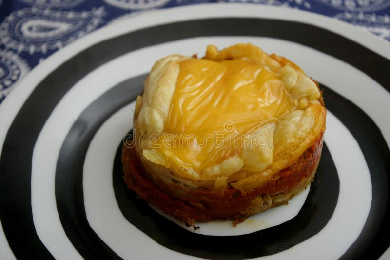 Pies with cheese and tuna fish. Some pies with tuna fish, cheese and paprika stock photos