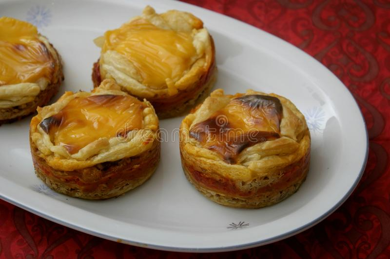 Pies with cheese and tuna fish. Some pies with tuna fish, cheese and paprika stock images