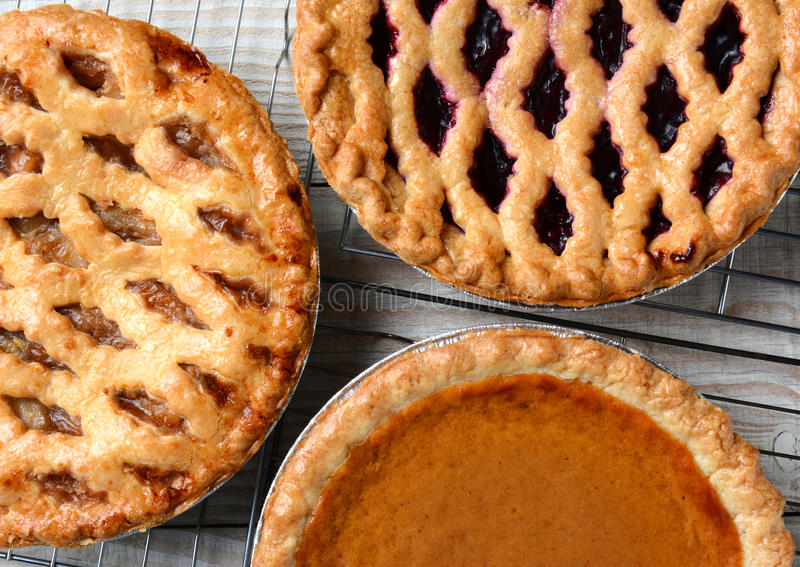 Pies on Cooling Racks royalty free stock photos