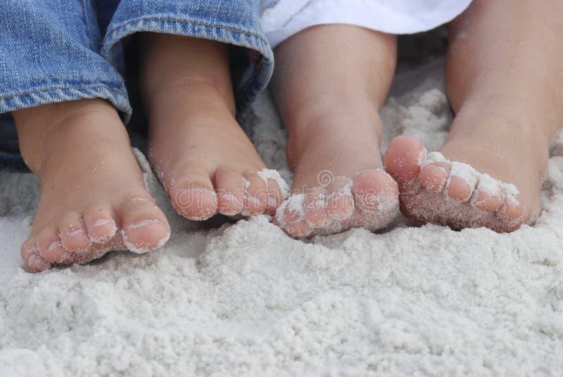 Pies de la playa de Sandy imágenes de archivo libres de regalías