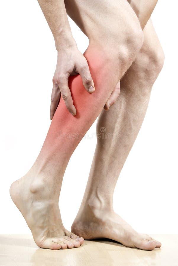 Pies del dolor de pierna marcados en rojo fotografía de archivo libre de regalías