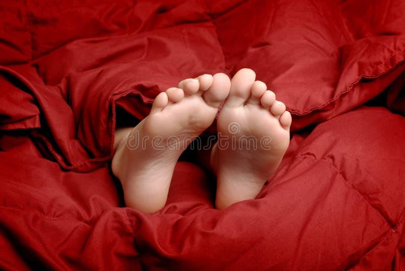 Pies el dormir foto de archivo libre de regalías