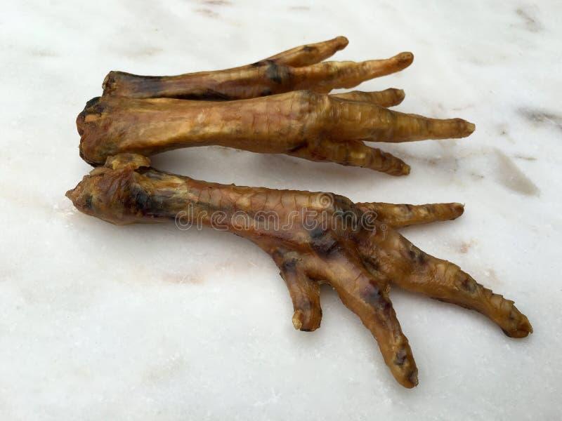 Pies secados del pollo imágenes de archivo libres de regalías